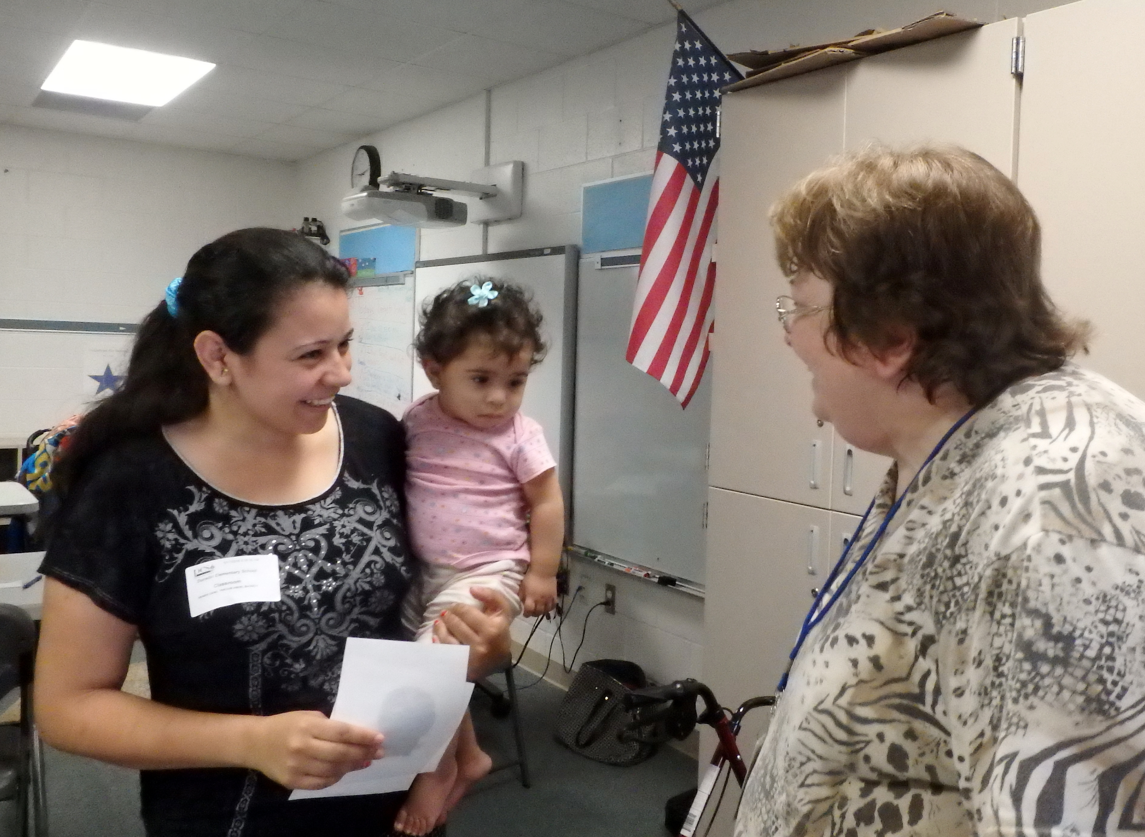 Linda Grimshaw talks with a student and her daughter at Dunedin Elementary School