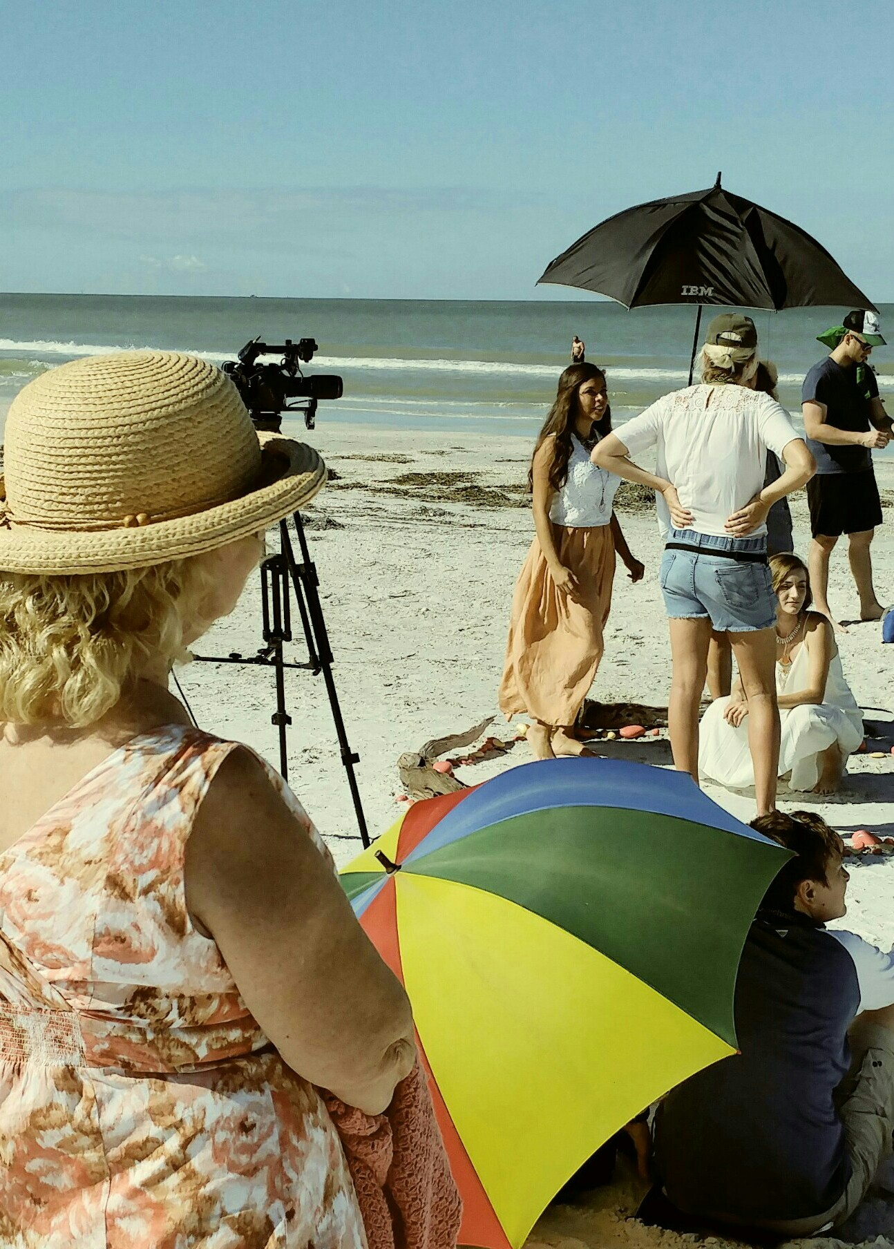 Jan Demers, LCUP tutor, watches English Language Learner Ximena Orozco act during the filming of A Bright Second on the beach in St. Petersburg.